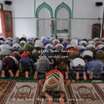 People praying inside a mosque
